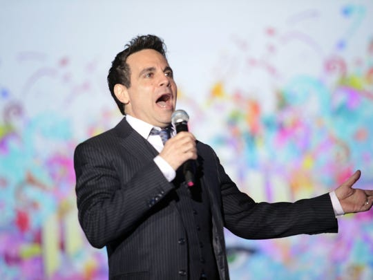 Comedian Mario Cantone works the crowd at the 21st annual Steve Chase Humanitarian Awards.