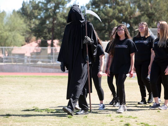 The grim reaper walks off the field during the filming of a DUI prevention video. The film will be shown on public access channels.