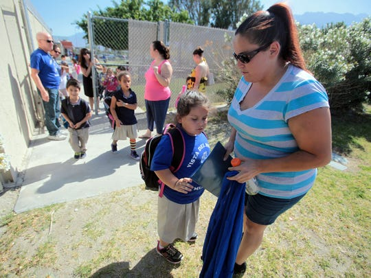 Milan Alaniz picks up her daughter Annabella, 5, from kindergarten on Monday at Vista Del Monte Elementary School in Palm Springs.
