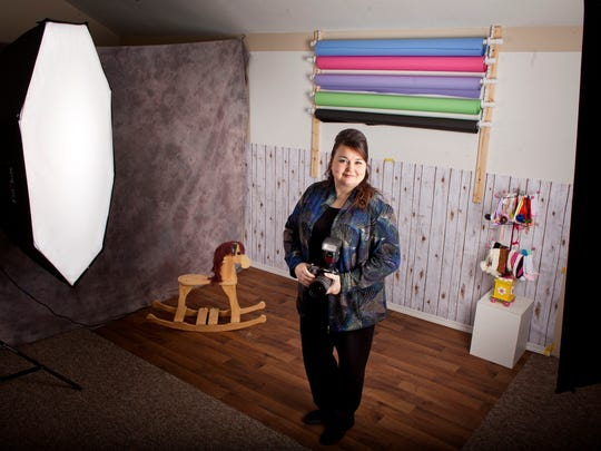 Photographer Kelly Torres poses in her studio Wednesday in Fort Gratiot. For five years, Torres has volunteered with Now I Lay Me Down To Sleep, photographing families with babies who are stillborn or at risk of dying as newborns.