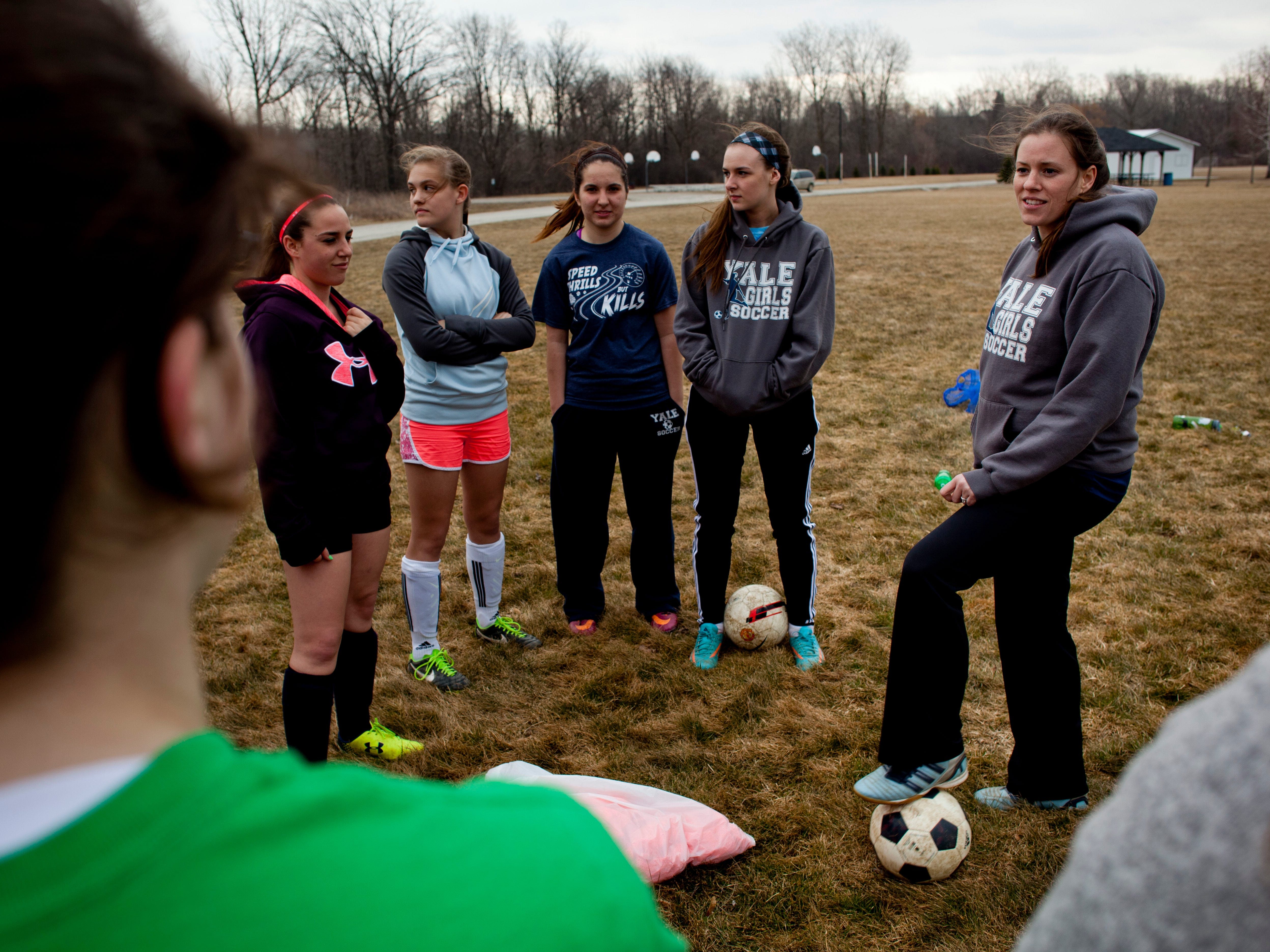 Coach Cora Heyboer talks with players during practice Thursday at Brockway Township Park.
