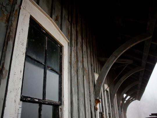 Paint is seen peeling from the side of the train depot Thursday, April 9, 2015 at the Sanilac County Historic Village and Museum. Volunteers are needed to help maintain the property.