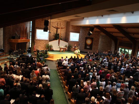 Family and friends of Jerry J. Helfer attend the Greece deputy supervisor's memorial service Saturday at Hope Lutheran Church in Greece.