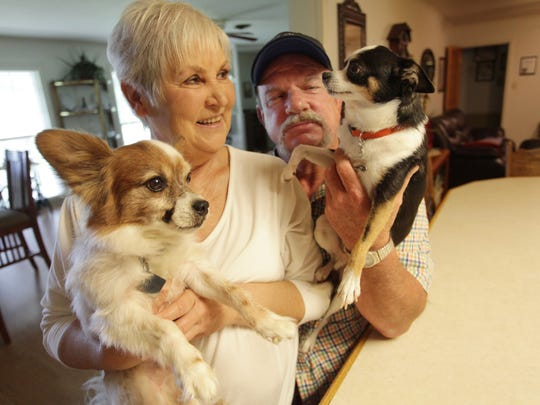 Ronnie and Lynda Hinson are pictured with their pets, Junior and Goober.