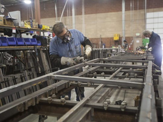 Employees of CargoGlide in the Fort Pierce Industrial Park manufacture sliding racks for truck beds.