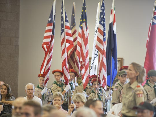 Boy scouts of Troop 1827 conduct the flag ceremony