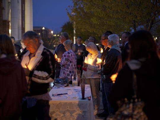 A candlelight vigil in remembrance of Jerrica Christensen is held at the Washington County Courthouse Thursday.