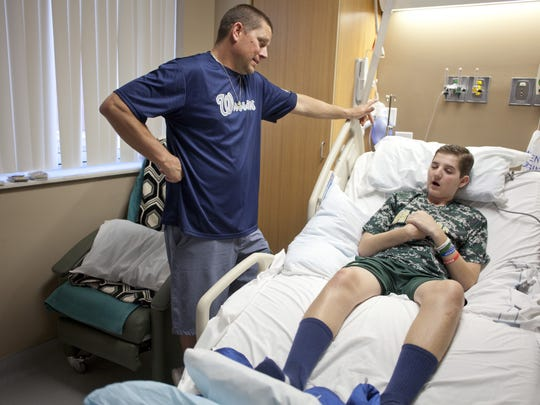 Britton Shipp and father Jesse Shipp discuss Britton's progress and effort since the accident. Tuesday, March 10, 2015.