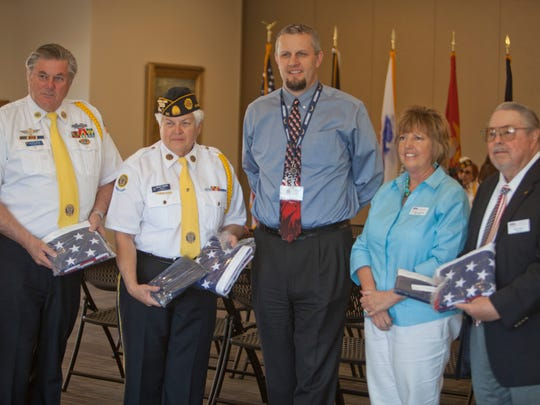 Representatives from Avalon Healthcare donate flags to American Legion Post 90 members Wednesday, April 1, 2015.