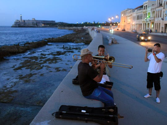 Franklin Reyes, APMusicians practice in Havana in July 2013. Aside from the tourism industry, some businesses that stand to profit the most are agricultural firms, financial institutions and medical clinics.
