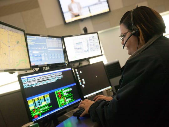 Public safety operator Lisa McNulty answers calls in the 911 call center at the Cpl. Paul J. Sweeney Public Safety Building in New Castle on Wednesday. McNulty fields incoming calls before routing them to the proper agency for response.