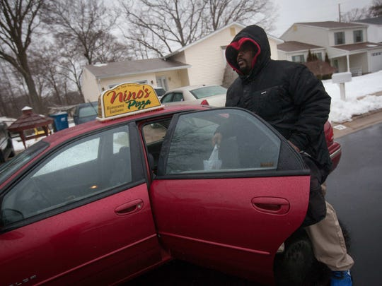 Nino's Pizza delivery driver Dwayne Robinson goes out for a delivery Tuesday.