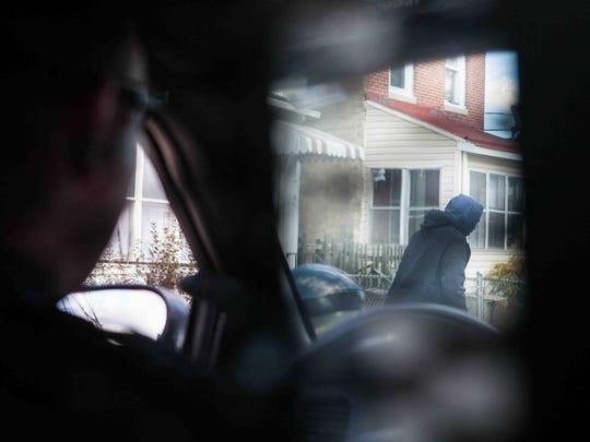 Wilmington Police Cpl. Devon Jones patrols a neighborhood on March 17 as part of Operation Disrupt.