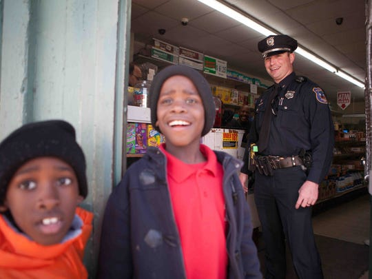 Cpl. Devon Jones stops by Eddie's Market along North Spruce and East 22nd streets as he does a foot patrol in the neighborhood as part of Operation Disrupt.