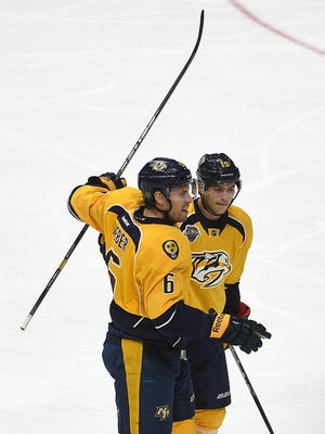 Predators defenseman Shea Weber celebrates with teammate Calle Jarnkrok after Weber scored against the Canadiens in the first period.