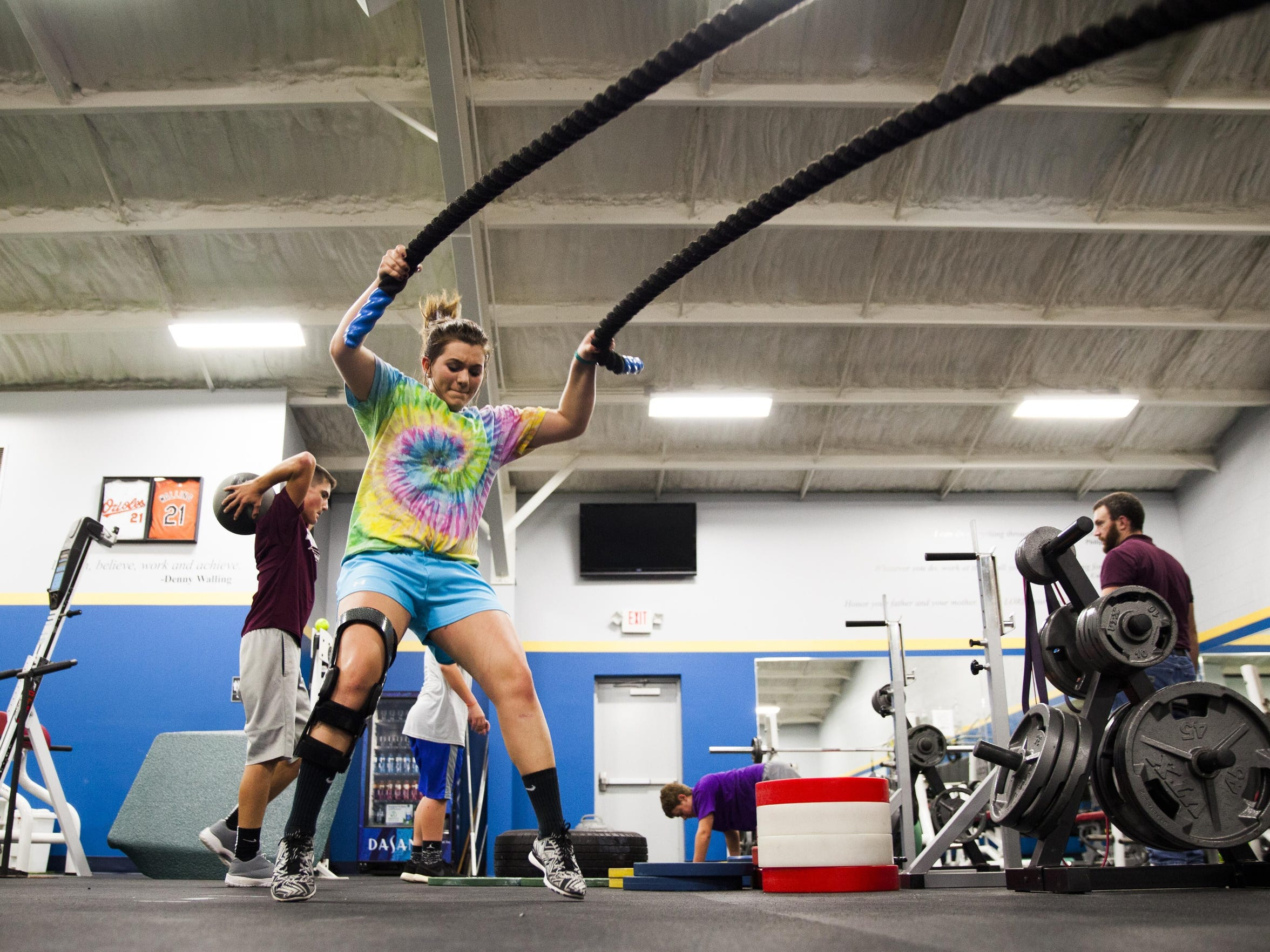 Kayley Campbell, who tore her ACL twice while playing softball at Stuarts Draft High School, works through physical therapy exercises on Thursday, Oct. 29, 2015.