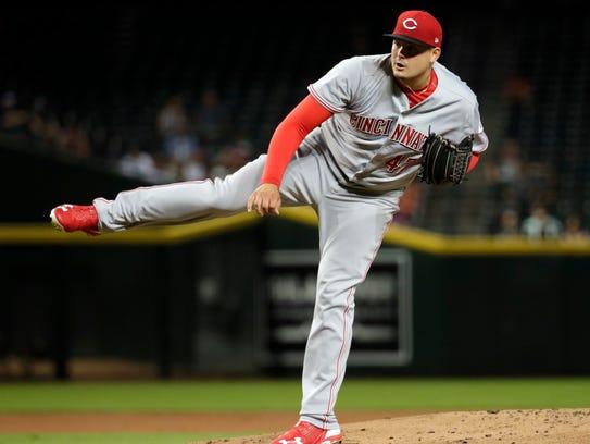 Cincinnati Reds starting pitcher Sal Romano (47) throws