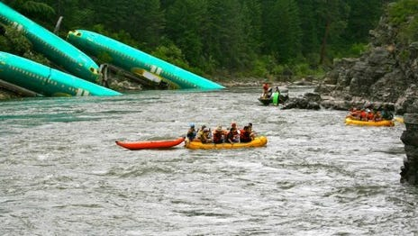 Boeing 737 fuselages are seen in a Montana river in this July 5, 2014, photo by Kyle Massick that was obtained by Gannett TV station King 5 of Seattle.