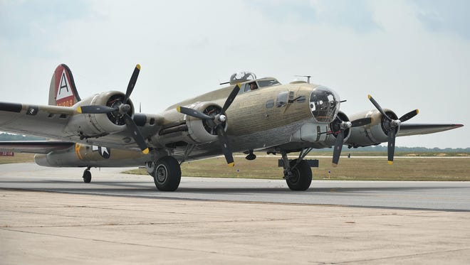 A B-17 bomber taxis on the tarmac at Millville Municipal Airport after landing for tours and flight experiences, Wednesday in Millville.