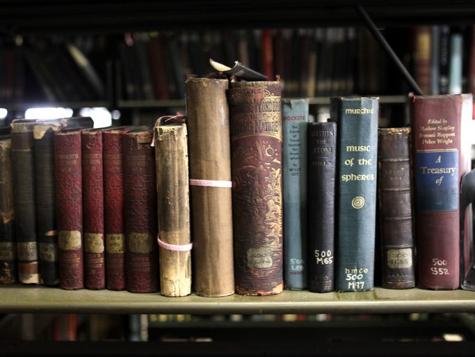 Old books on the shelf at the Mercantile Library.