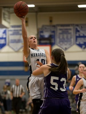 Manasquan's Dar Mabrey goes up with shot against Rumson's Megan Volker. Rumson-Fair Haven vs Manasquan Girls Basketball in the Central Group II championship game in Manasquan, NJ on March 8, 2016