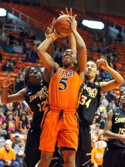File: UTEP's Kayla Thornton goes up for a shot against Southern Miss defenders Wendy Miller, left, and Teri Berry on February 10, 2013 at the Don Haskins Center.
