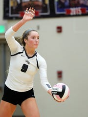 Ankeny Centennial junior outside hitter Kenna Sauer (9) serves as the Sioux City East Black Raiders battles against the Ankeny Centennial Jaguars during the Class 5A regional final volleyball match at Ankeny Centennial High School, 2220 NW State St, in Ankeny.