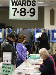 Poll workers check in a steady stream of electors at the Hale Corners Village Hall for the Spring election on April 3 with a new Hales Corners president and a $16 million referendum for improvments within the Whitnall School District on the ballot.