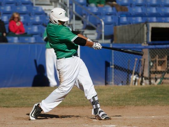 Farmington's Ethan Secrest hits a two-run double on Thursday against Durango, Colo., at Ricketts Park in Farmington.