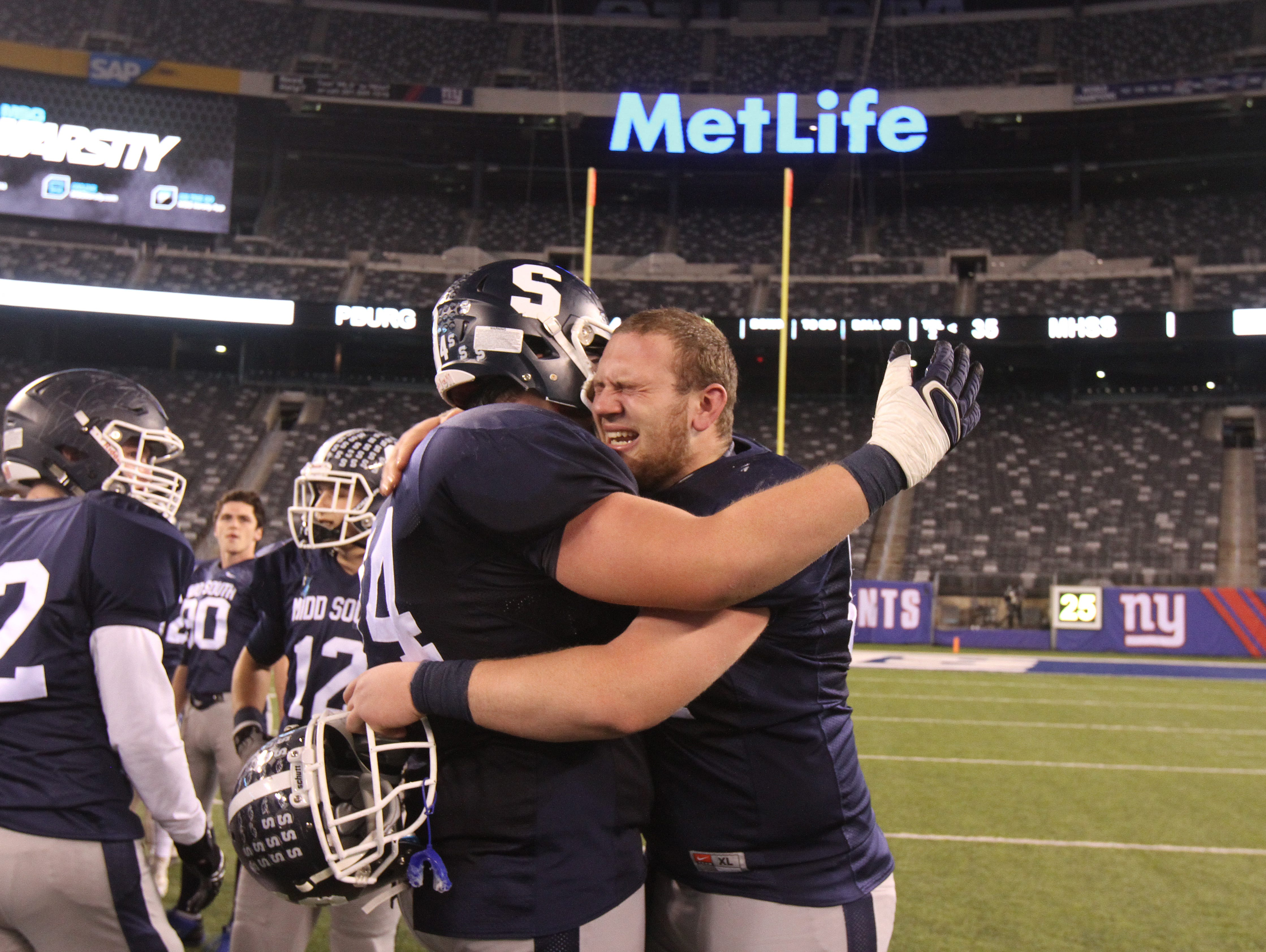 Middletown South High School football players Joe Rutkowski and Michael Wilson celebrate winning the state title against Phillipsburg in the North 2 Group IV game of the 2015 NJSIAA/MetLife Stadium High School Football Championships at MetLife Stadium in East Rutherford, NJ Saturday December 5, 2015.