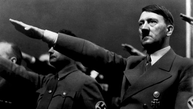 "A picture dated 1939 shows German Nazi Chancellor Adolf Hitler giving the nazi salute during a rally next to ""Deputy Furhrer"" Rudolf Hess."
