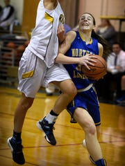 Viking guard Zoe Zerman drives along the baseline to