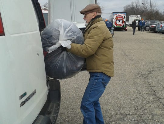 Larry Bowen, adds another bag of coats to Community