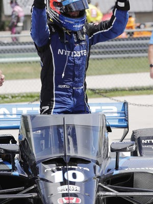 IndyCar driver Felix Rosenqvist reacts after winning Race 2 of the REV Group Grand Prix on Sunday at Road America in Elkhart Lake, Wis.