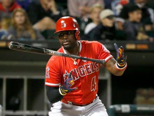 Los Angeles Angels' Brandon Phillips lets go of his bat as he takes the first pitch from Chicago White Sox starting pitcher Reynaldo Lopez for a ball during the sixth inning of a baseball game Wednesday, Sept. 27, 2017, in Chicago. (AP Photo/Charles Rex Arbogast)