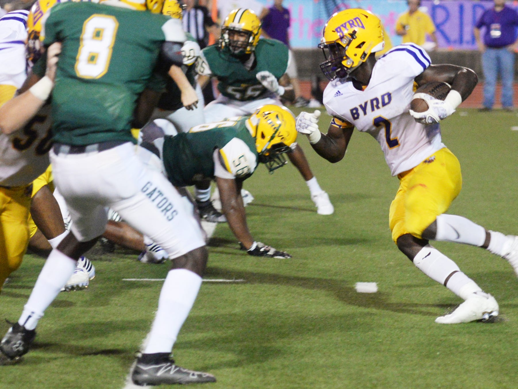 Byrd's Javien Wilson runs with the ball Thursday evening at Lee Hedges Stadium.