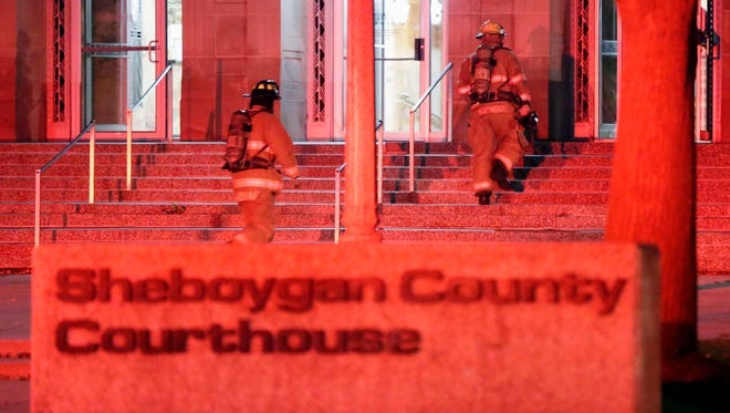 Sheboygan firefighters walk up the steps of the Sheboygan County Courthouse to investigate a fire alarm at the building Thursday October 20, 2016 in Sheboygan.
