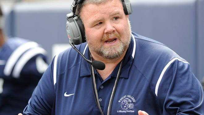 Wesley's Mike Drass works with his defense during a game against Kean recently.