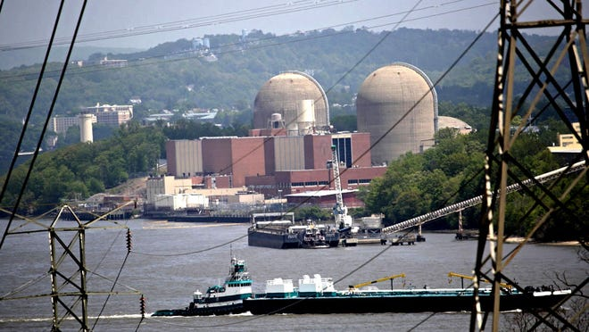 A tanker goes past Indian Point on May 11, two days after a transformer explosion and fire at the nuclear power plant.