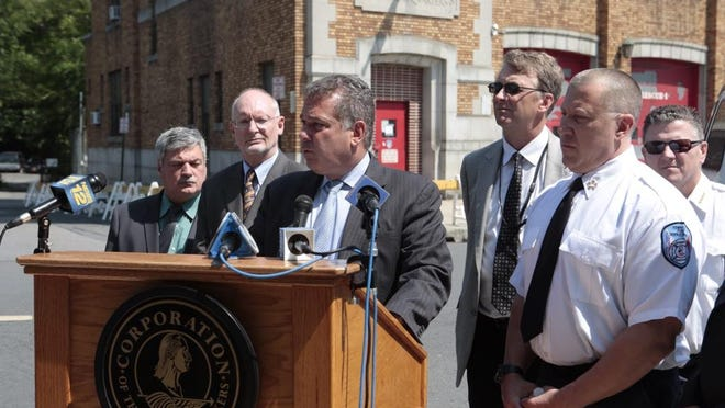 Yonkers Mayor Michael Spano speaks to the press about the condemning of the School Street fire department building on June 8, 2015.
