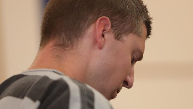 Former UC police officer Ray Tensing reacts to the judge setting his bond at $1 million Thursday morning.