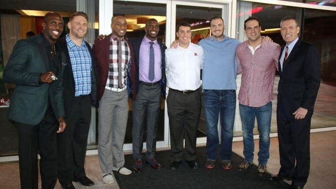 Rutgers coach Chris Ash (white shirt) and athletic director Pat Hobbs (far right) were surrounded Saturday by former Rutgers football stars.