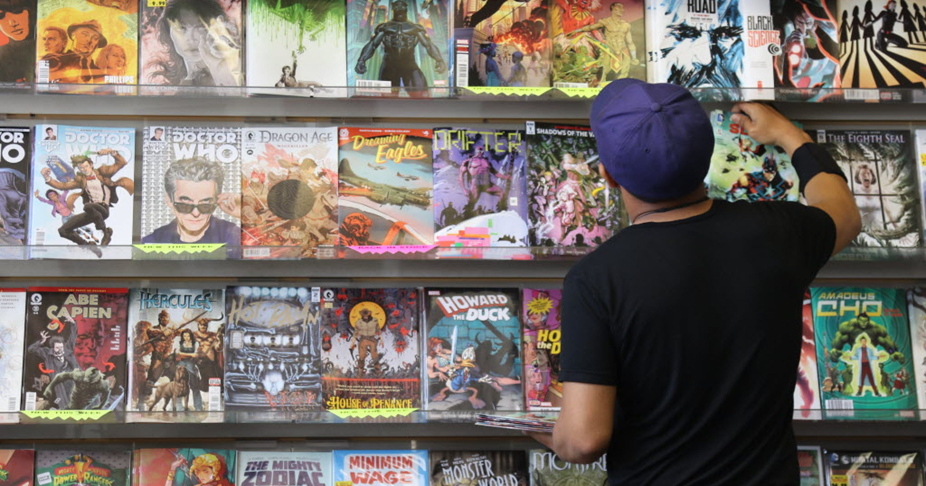 5698d2255d1 Superheroes on big screen are big hit for comic shops