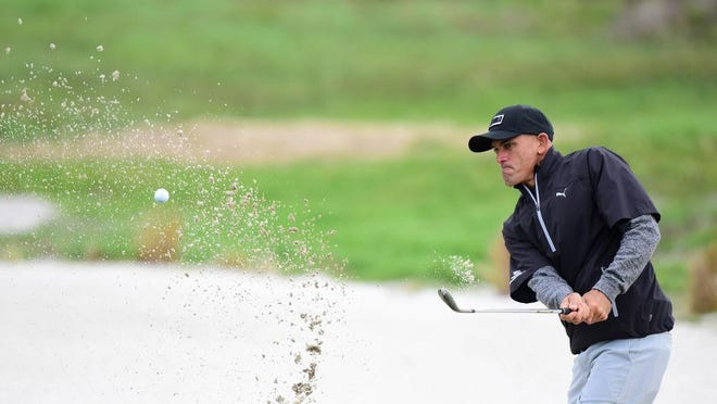 PEBBLE BEACH, CA - FEBRUARY 09: Kelly Slater hits from the bunker on the 12th hole during Round One of the AT&T Pebble Beach Pro-Am at Monterey Peninsula Country Club on February 9, 2017 in Pebble Beach, California. (Photo by Harry How/Getty Images)