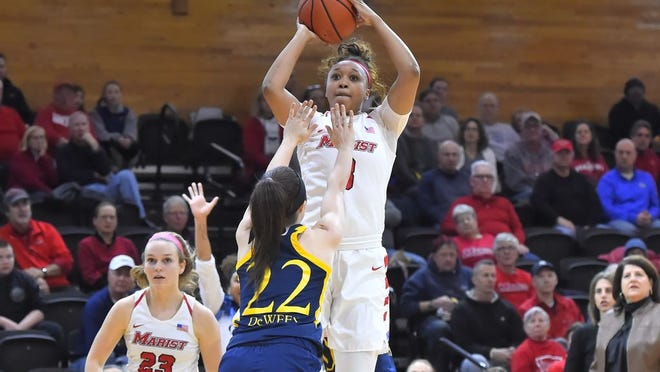 Alana Gilmer shoots over a Quinnipiac defender during Thursday's game at the McCann Arena in Poughkeepsie. Marist prevailed 73-60.