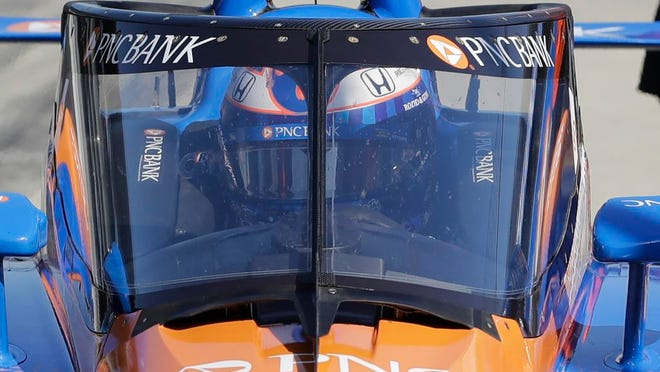 From Oct. 2, 2019, Scott Dixon, of New Zealand, sits in his car during the Aeroscreen testing at Indianapolis Motor Speedway in Indianapolis. After 10 months of testing, the canopy-shaped cockpit protection is intended to protect the driver from debris.