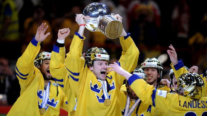 Staffan Kronwall reacts with the trophy,  after winning the 2013 Ice Hockey IIHF World Championships gold medal match against  Switzerland, at the Ericsson Globe Arena in Stockholm, Sweden, Sunday, May 19, 2013. (AP Photo/Lehtikuva, Martti Kainulainen) FINLAND OUT. NO THIRD PARTY SALES.
