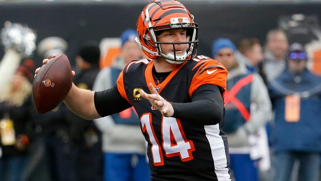From Dec. 15, 2019, Cincinnati Bengals quarterback Andy Dalton passes in the first half of an NFL football game against the New England Patriots in Cincinnati. The Bengals cleared the way for Joe Burrow to lead the team by releasing quarterback Andy Dalton, who holds several of the franchise's passing records but couldn't lead the woebegone Bengals deep into the playoffs. The move Thursday, April 30, 2020, gives Dalton, who had a year left on his deal, a chance to compete for a job with another team.