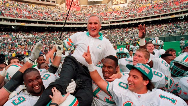 From Nov. 14, 1993, Miami Dolphins coach Don Shula is carried on his team's shoulders after his 325th victory, against the Philadelphia Eagles in Philadelphia. Shula, who won the most games of any NFL coach and led the Miami Dolphins to the only perfect season in league history, died Monday, May 4, 2020, at his South Florida home, the team said. He was 90.