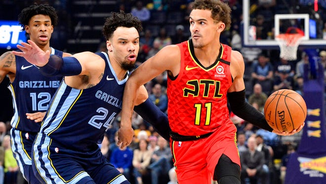 From March 7, 2020, Atlanta Hawks guard Trae Young (11) handles the ball against Memphis Grizzlies guard Dillon Brooks (24) in the first half of an NBA basketball game in Memphis, Tenn. Lloyd Pierce sees improvement in the five players he calls the core of the rebuilding Atlanta Hawks. The coach knows he needs to deliver proof of that improvement next season. There was no proof in the standings of improvement in this shortened season despite the emergence of guard Trae Young as an All-Star in only his second season.